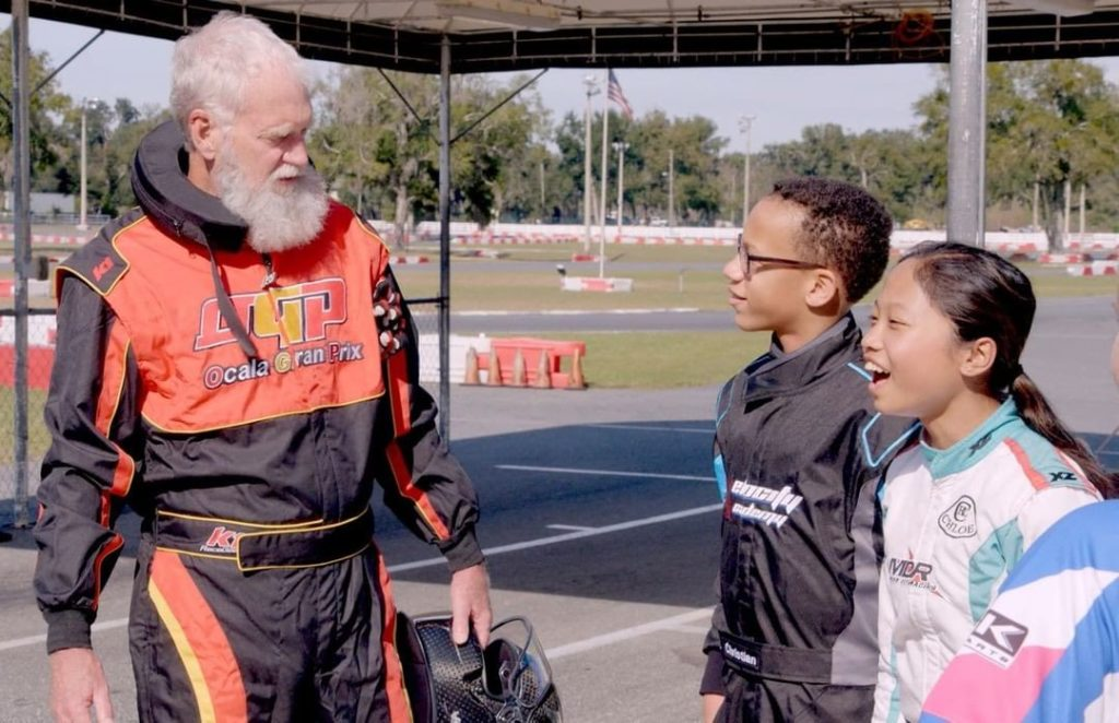 "David Letterman races Christian Rutty, middle, and Chloe Chambers in an episode about Formula One champion Lewis Hamilton in Season 2 of ""My Next Guest Needs No Introduction with David Letterman."" (Courtesy of Netflix)"